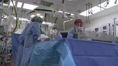 Operating room with surgery in progress - stock footage