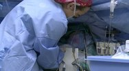 Ice packs are applied to heart patient Stock Footage