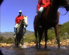 Lesotho Horsemen in Mountain River and Splash Camera GFSD Stock Footage