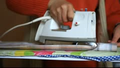 Woman ironing Stock Footage