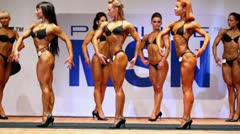 Seven bodybuilders female poses at Open Cup of bodybuilding and fitness - stock footage