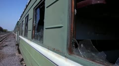 Motion along abandoned train, broken windows at railcar Stock Footage