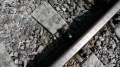 Rails and cross ties of railway among stones, shown in motion Stock Footage