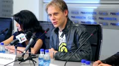 Popular Dutch DJ Armin Van Buuren smiles at press conferences Stock Footage