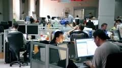 Several people work in office of Russian Information Agency RIA Novosti Stock Footage