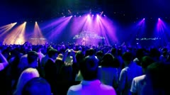 Singer dance on stage, lot of people at rave party Stock Footage