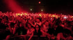 Spectators stand behind fencing at Armin Only show in concert hall - stock footage