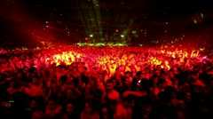 Lot of young people in large stadium at rave party - stock footage