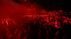 Crowd stand in smoke at rave party - stock footage