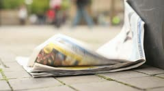 Newspaper on Ground HD File - stock footage