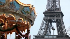 Eiffel Tower and Carousel (merry go round) in Paris, France, French Attractions Stock Footage