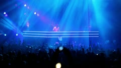 Popular Dutch DJ Armin Van Buuren on stage with blue illumination Stock Footage