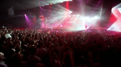 Girls dance on stage at popular dutch DJ Armin Van Buuren show - stock footage