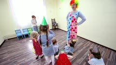 Two clowns play with kids at birthday celebration in club TEMA - stock footage