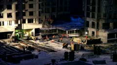 Labourers work at construction site on winter night Stock Footage