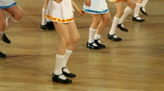 Several girls dance, only legs are visible Stock Footage