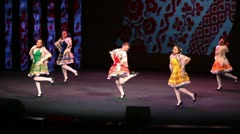 Five girls with shawls dance on scene Stock Footage