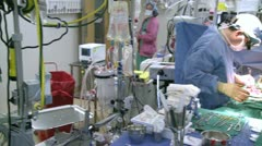 Stock Video Footage of Pan left to right of open heart surgery (2 of 2)