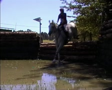 Horse and Rider jumping an Eventing Water Jump GFSD Stock Footage