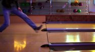 Two men throw bowling ball on parallel lanes in club Stock Footage