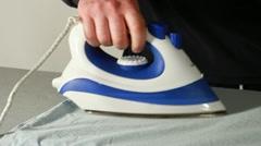 Man ironing a shirt Stock Footage