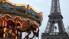 Eiffel Tower and Carousel (merry go round) in Paris, France, French Architecture - stock footage