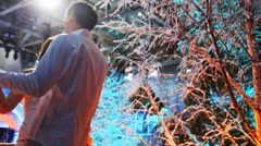 Couple dances near snowy trees at winter night Stock Footage