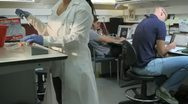 Dolly of people working in a lab Stock Footage