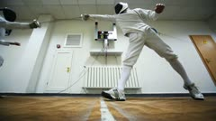 Boy does girl prick in training sword fencing at club Dynamo Stock Footage