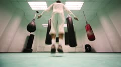 Man quickly jumps on rope in  hall boxing Stock Footage