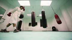 Man in gloves makes some final training session of boxing marathon, part11 Stock Footage