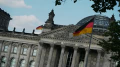 Berlin - Reichstag with Waving Flags - stock footage
