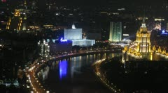 White house stand at night on river bank to the left of hotel Ukraina Stock Footage
