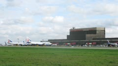 Planes TRANSAERO stand on field near building of airport Stock Footage
