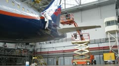 Flight mechanics spend checkup of plane Aeroflot in hangar Sheremetyevo airport Stock Footage