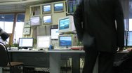 Dispatchers are on a workplace in front of  supervisory console airport Stock Footage