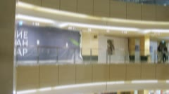 Lift move upwards and downwards in shopping center Afimall City Stock Footage