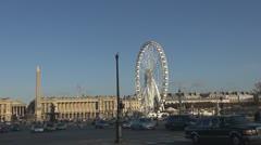 Place de la Concorde and Ferris-wheel paris france street traffic car day Stock Footage