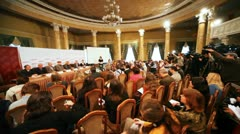 Presentation of film Master and Margarita with journalists in big round hall Stock Footage