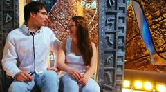 Couple sits nicely talking on background of Egyptian scenery Stock Footage