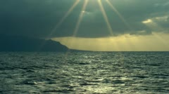 Sunset ocean sun rays slow motion Stock Footage