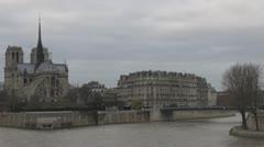 Cathedral Notre Dame de Paris and Île de la Cité river seine ship boat building  Stock Footage