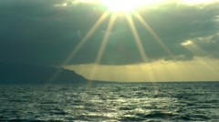 Sunset ocean sun rays 50p Stock Footage