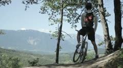 Cyclist in a forest - stock footage