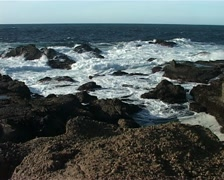 Zoom out from Waves Breaking on Rocks GFSD Stock Footage