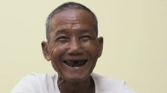 Portrait of happy old asian man smiling at camera - stock footage