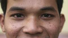 Eyes of happy young asian man looking at camera - stock footage