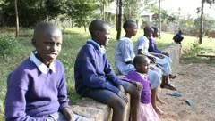 African Children Watching Volleyball Game Stock Footage