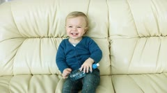 Laughing baby boy a bottle of water Stock Footage