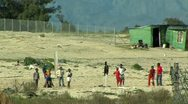 Soccer in township south africa Stock Footage